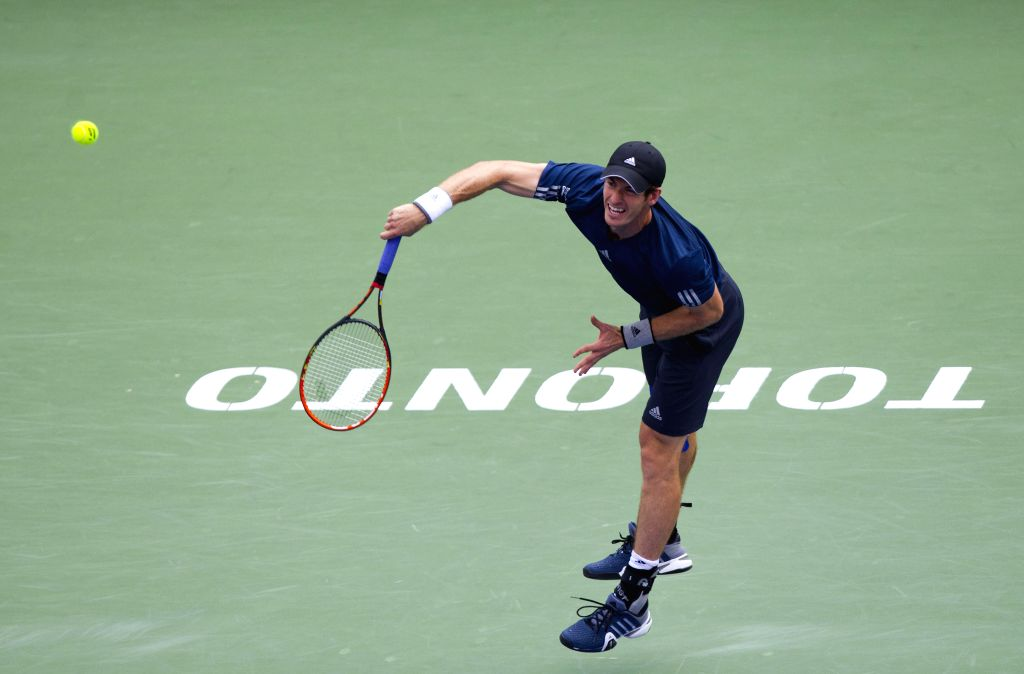 Andy Murray of Britain serves during the men's singles quarterfinal against Jo-Wilfried Tsonga of France at the 2014 Rogers Cup in Toronto, Canada, Aug. 8, 2014. Andy
