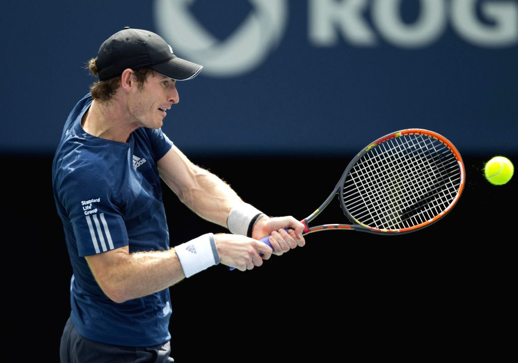 Andy Murray of Britain returns the ball during the men's singles quarterfinal against Jo-Wilfried Tsonga of France at the 2014 Rogers Cup in Toronto, Canada, Aug. 8, .