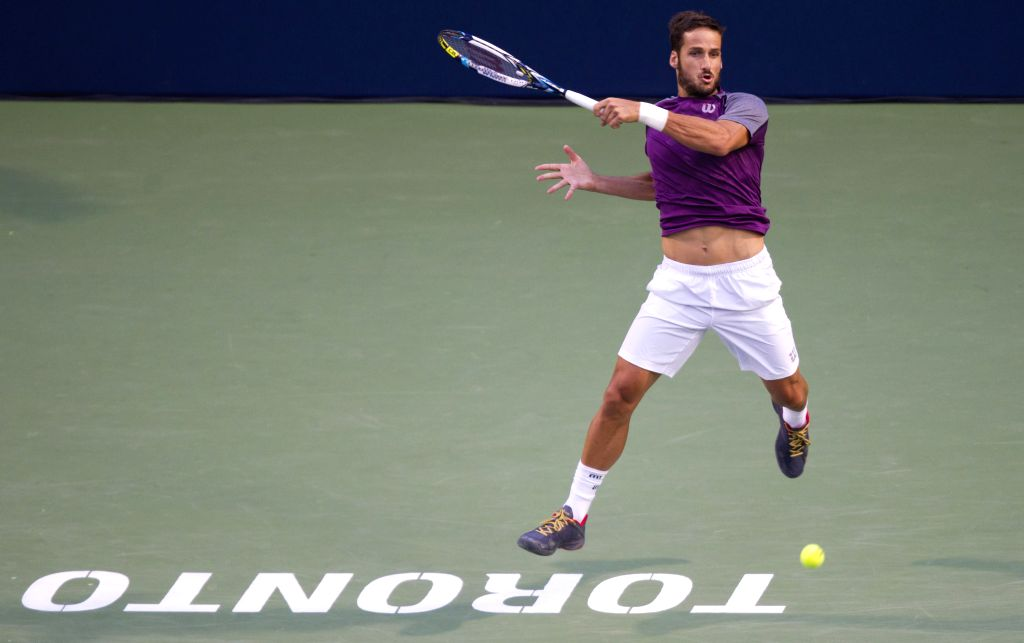 Feliciano Lopez of Spain returns the ball during the quarterfinal of men's singles against Milos Raonic of Canada at the 2014 Rogers Cup in Toronto, Canada, Aug. 8, ..