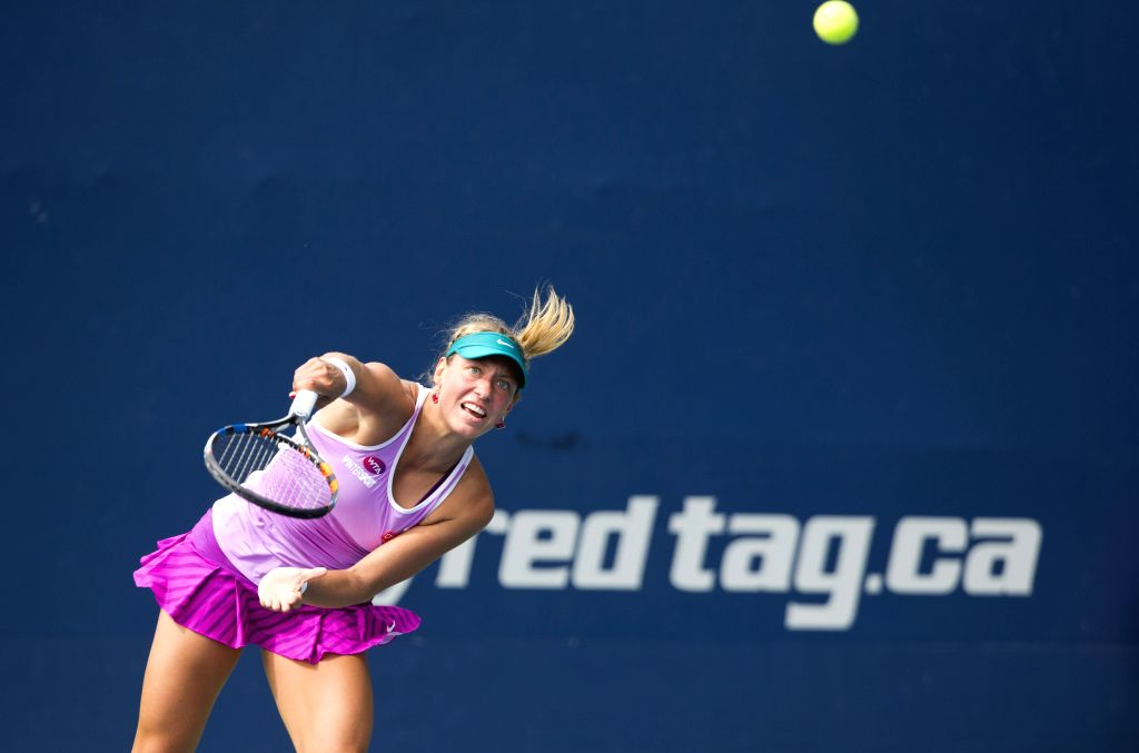 Yanina Wickmayer of Belgium serves against Donna Vekic of Croatia during the first round of women's singles qualifying match at the 2015 Rogers Cup in Toronto, ...