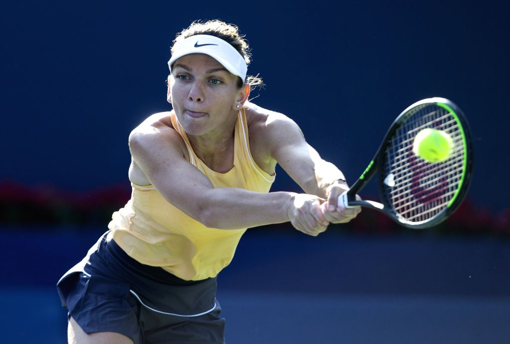 TORONTO, Aug. 9, 2019 (Xinhua) -- Simona Halep of Romania returns the ball against Svetlana Kuznetsova of Russia during the third round of women's singles match at the 2019 Rogers Cup in Toronto, Canada, Aug. 8, 2019. Simona Halep of Romania won 2-0.