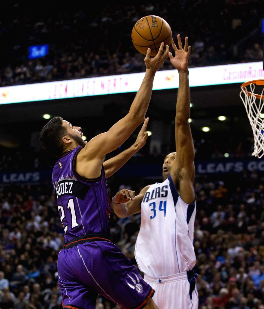 Toronto (Canada): Greivis Vasquez(L) of Toronto Raptors goes to the basket during the NBA game against Dallas Mavericks at Air Canada Center in Toronto, Canada, Nov. 28, 2014. Raptors lost 102-106. ..