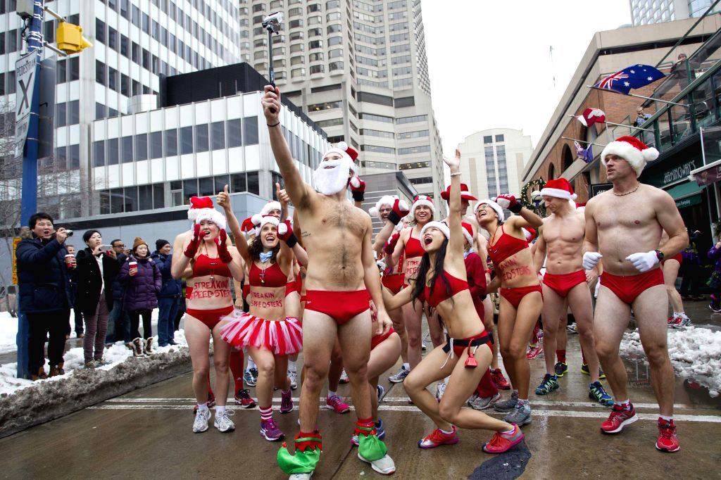 Participants in red bathing suits take a selfie before the 2014 Toronto Santa Speedo Run event in Toronto, Canada, Dec. 13, 2014. Dozens of participants took part ..