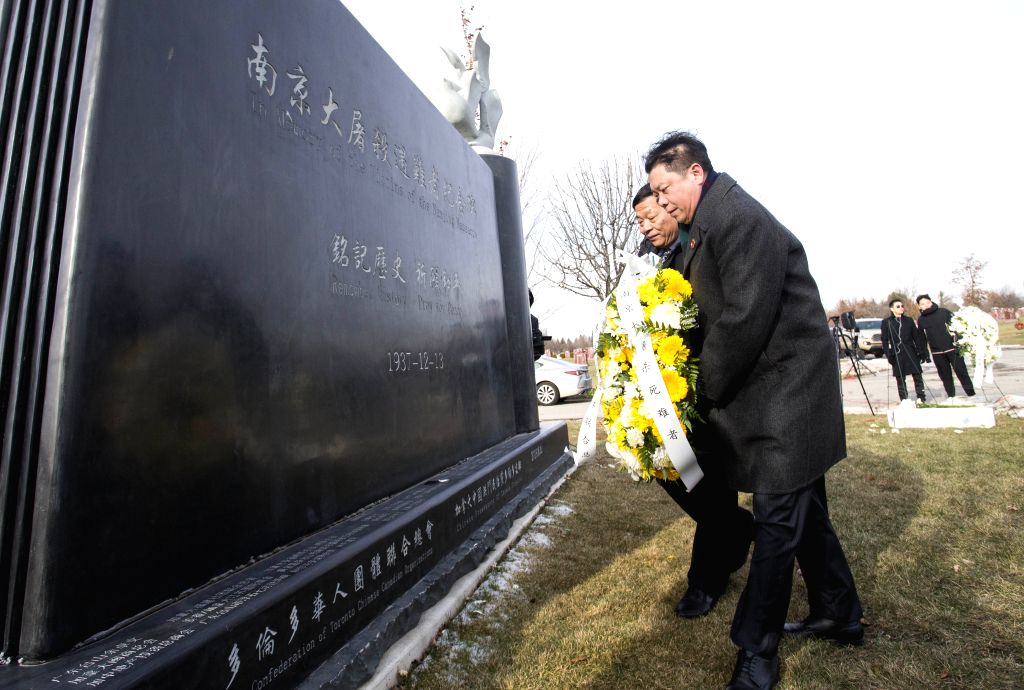 TORONTO, Dec. 13, 2019 - People lay a wreath during a memorial ceremony in Richmond Hill, Greater Toronto Area, Canada, Dec. 13, 2019. Hundreds of people attended a memorial ceremony on Friday to ...