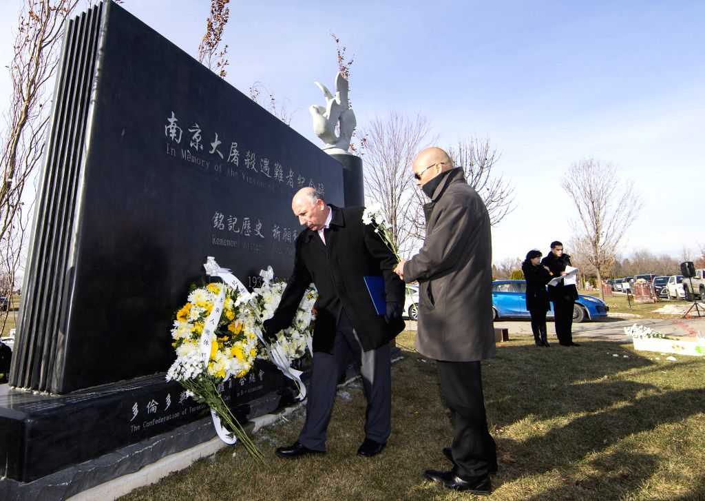 TORONTO, Dec. 13, 2019 - People lay flowers during a memorial ceremony in Richmond Hill, Greater Toronto Area, Canada, Dec. 13, 2019. Hundreds of people attended a memorial ceremony on Friday to ...