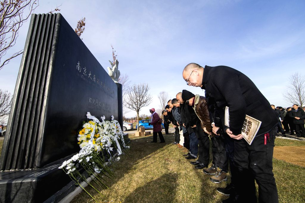 TORONTO, Dec. 13, 2019 - People pay their respects during a memorial ceremony in Richmond Hill, Greater Toronto Area, Canada, Dec. 13, 2019. Hundreds of people attended a memorial ceremony on Friday ...