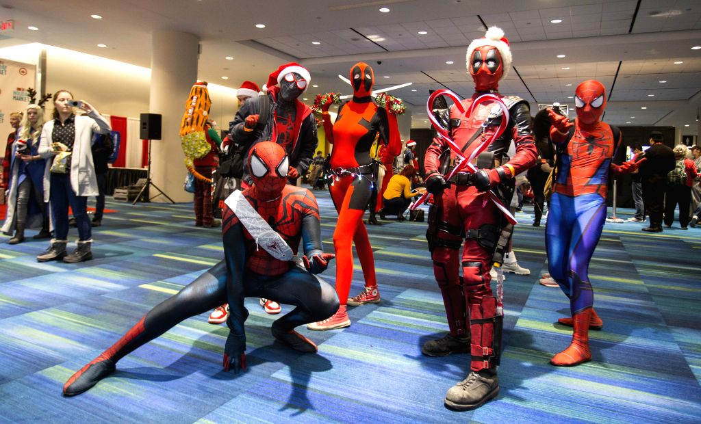 TORONTO, Dec. 7, 2019 - Cosplayers pose for photos during the 2019 Toronto Fan Expo Holiday Market in Toronto, Canada, Dec. 7, 2019. The annual one-day event was held here on Saturday to celebrate ...