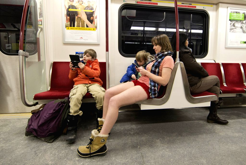 A participant takes part in the No Pants Subway Ride in Toronto, Canada, Jan. 11, 2015. Hundreds of people took part in this activity here on Sunday. (Xinhua/Zou ..