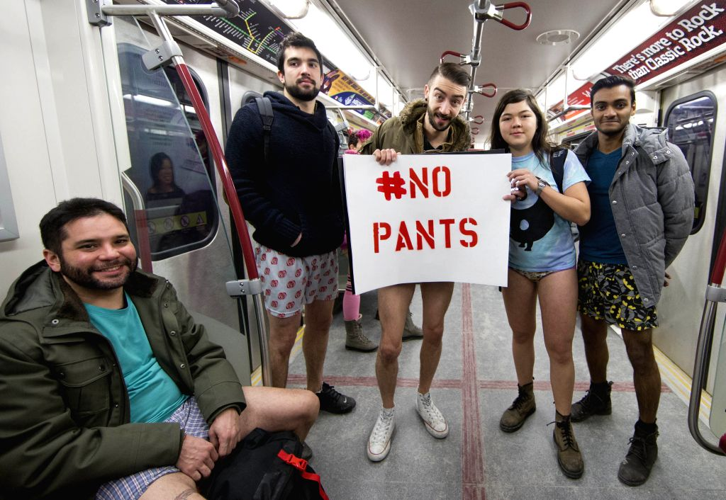 Participants take part in the No Pants Subway Ride in Toronto, Canada, Jan. 11, 2015. Hundreds of people took part in this activity here on Sunday. (Xinhua/Zou ...