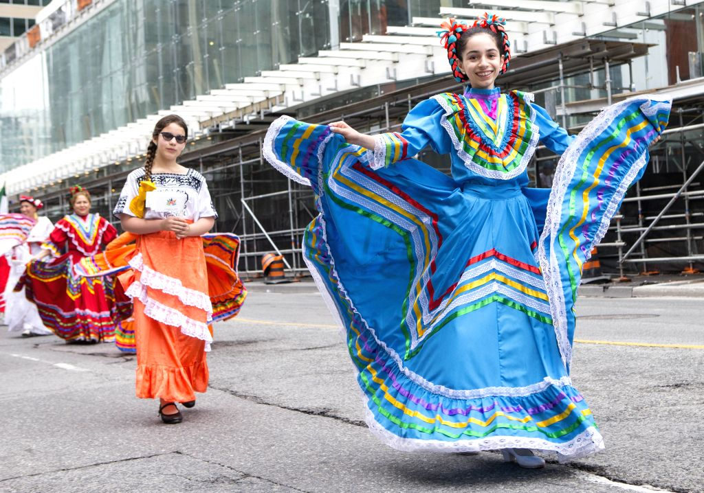 TORONTO, July 2, 2017 - A participant in Mexican traditional costume performs during the 2017 Canada Day Parade in Toronto, Canada, July 1, 2017. About 1,500 participants in different traditional ...