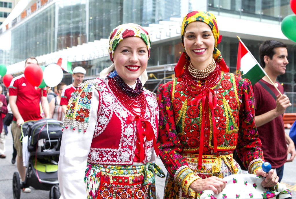 TORONTO, July 2, 2017 - Two participants in Hungarian traditional costumes pose for photos during the 2017 Canada Day Parade in Toronto, Canada, July 1, 2017. About 1,500 participants in different ...