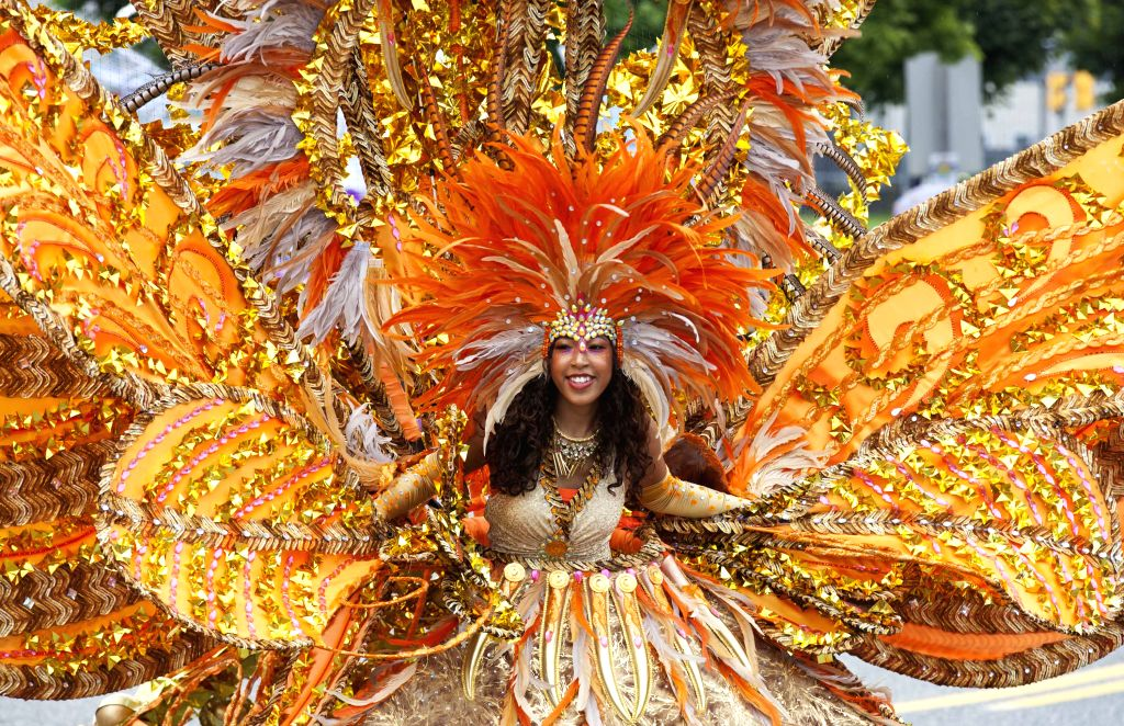 A girl performs with her float during the Junior Parade of the 2014 annual Toronto Caribbean Carnival in Toronto, Canada, July 19, 2014. As the largest Junior ...