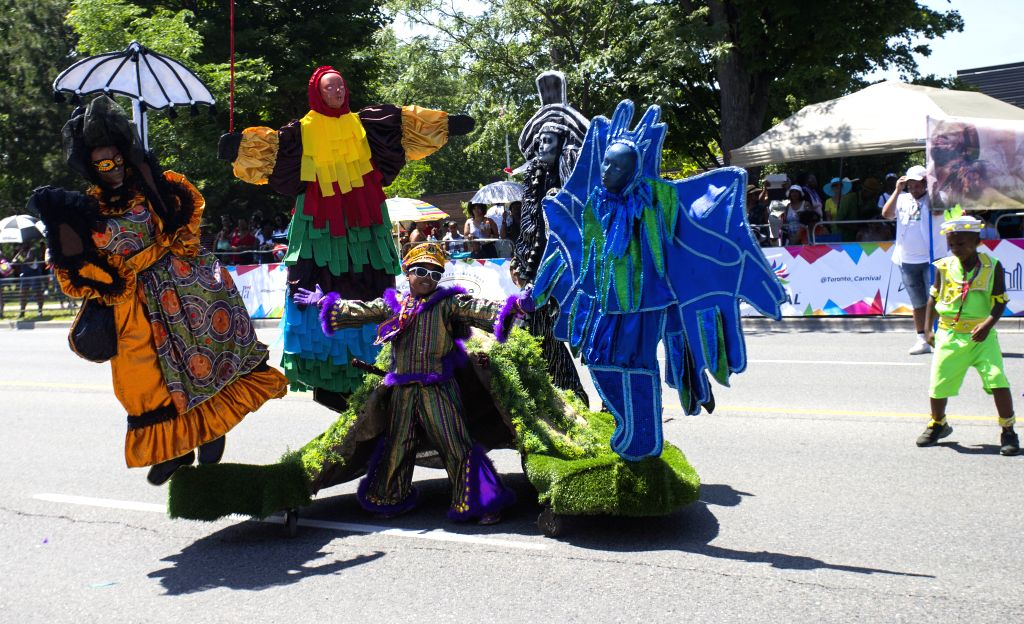 TORONTO, July 20, 2019 - A dressed-up boy dances during the Junior Carnival Parade of the 2019 Toronto Caribbean Carnival in Toronto, Canada, July 20, 2019. More than 2,000 young participants took ...