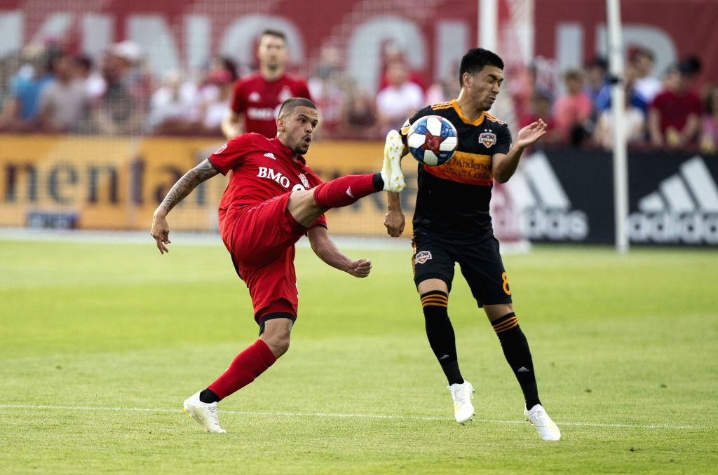 TORONTO, July 21, 2019 - Aruo (L) of Toronto FC vies with Memo Rodriguez of Houston Dynamo during their 2019 Major League Soccer(MLS) match at BMO Field in Toronto, Canada, July 20, 2019. Toronto FC ...