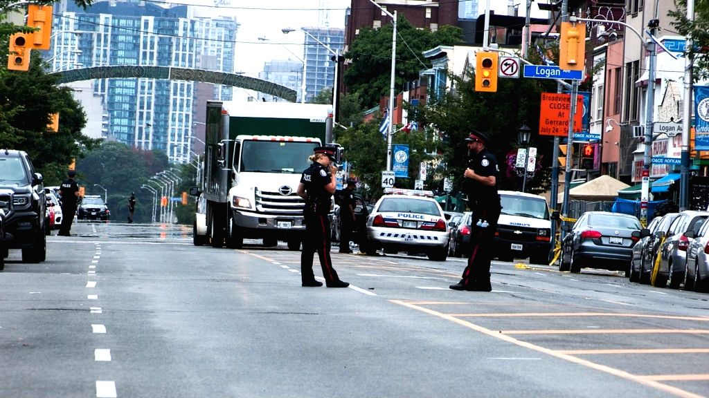 TORONTO, July 24, 2018 - Local policemen close the Danforth Street to search for evidence in Toronto, Canada, July 23, 2018. An 18-year-old female university student and a 10-year-old girl were ...