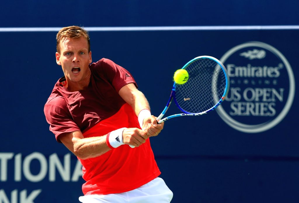 TORONTO, July 27, 2016 - Tomas Berdych of the Czech Republic returns the ball against Borna Coric of Croatia during their second round of men's singles match at the 2016 Rogers Cup in Toronto, ...