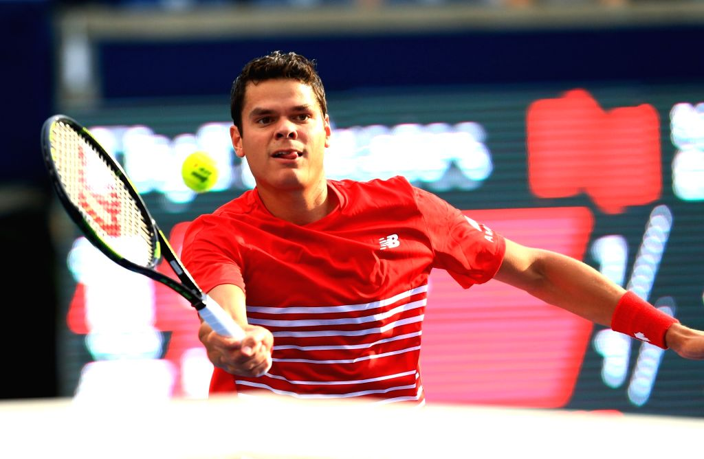 TORONTO, July 28, 2016 - Milos Raonic of Canada returns the ball against Yen-Hsun Lu of Chinese Taipei during their second round of men's singles match at the 2016 Rogers Cup in Toronto, Canada, July ...