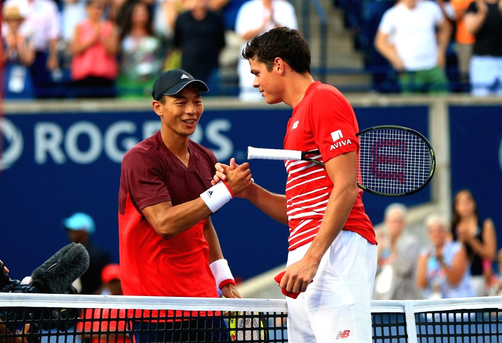 TORONTO, July 28, 2016 - Milos Raonic (R) of Canada shakes hands with Yen-Hsun Lu of Chinese Taipei after their second round of men's singles match at the 2016 Rogers Cup in Toronto, Canada, July 27, ...