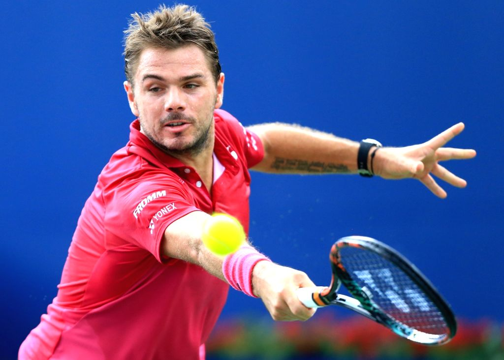 TORONTO, July 29, 2016 - Stan Wawrinka of Switzerland returns the ball against Jack Sock of the United States during their third round of men's singles match at the 2016 Rogers Cup in Toronto, ...