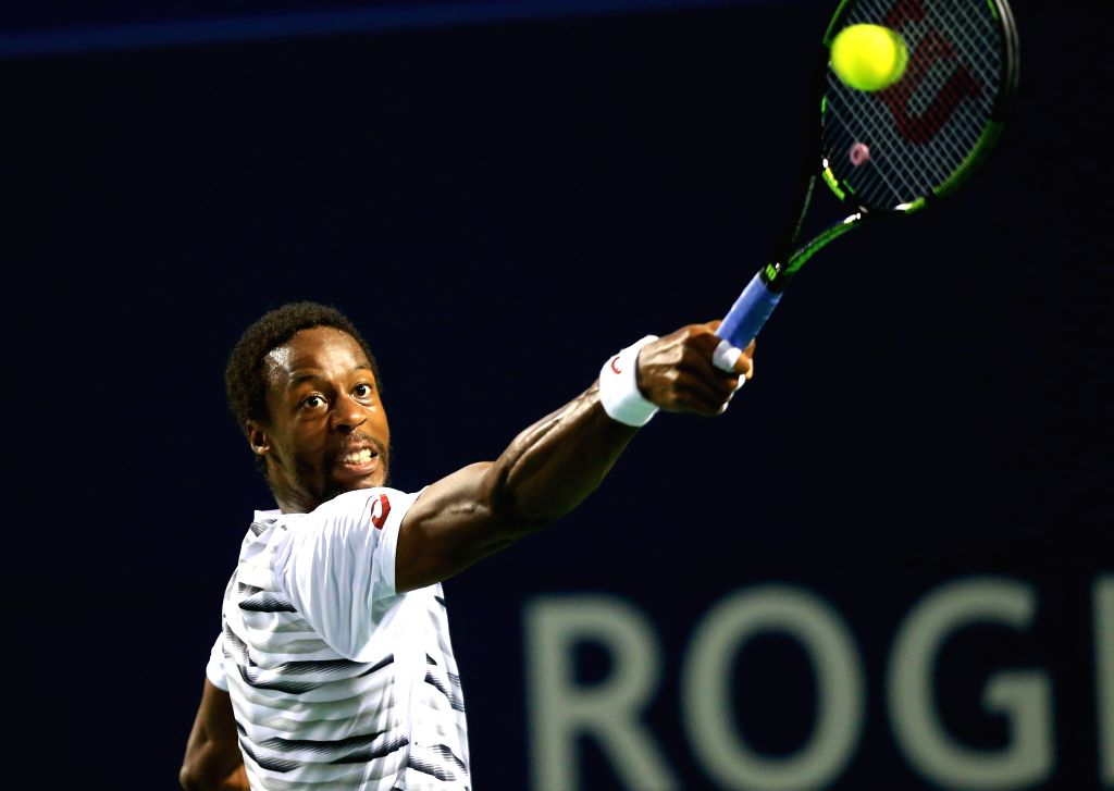 TORONTO, July 30, 2016 - Gael Monfils of France returns the ball against Milos Raonic of Canada during their quarterfinal match of men's singles at the 2016 Rogers Cup in Toronto, Canada, July 29, ...