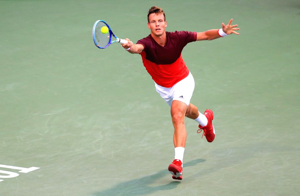 TORONTO, July 30, 2016 - Tomas Berdych of the Czech Republic returns the ball against Novak Djokovic of Serbia during their quarterfinal match of men's singles at the 2016 Rogers Cup in Toronto, ...