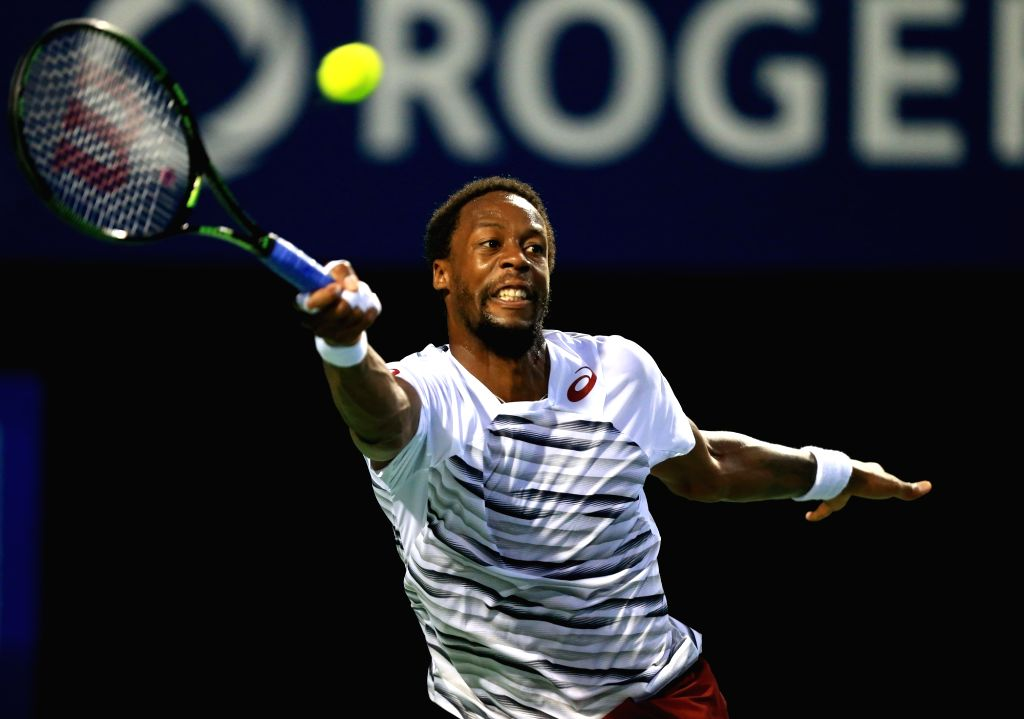 TORONTO, July 31, 2016 - Gael Monfils of France returns the ball during the semifinal match of men's singles against Novak Djokovic of Serbia at the 2016 Rogers Cup in Toronto, Canada, July 30, 2016. ...