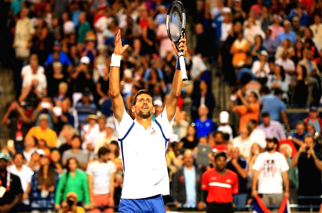 TORONTO, July 31, 2016 - Novak Djokovic of Serbia celebrates victory after the semifinal match of men's singles against Gael Monfils of France during the semifinal match of men's singles at the 2016 ...
