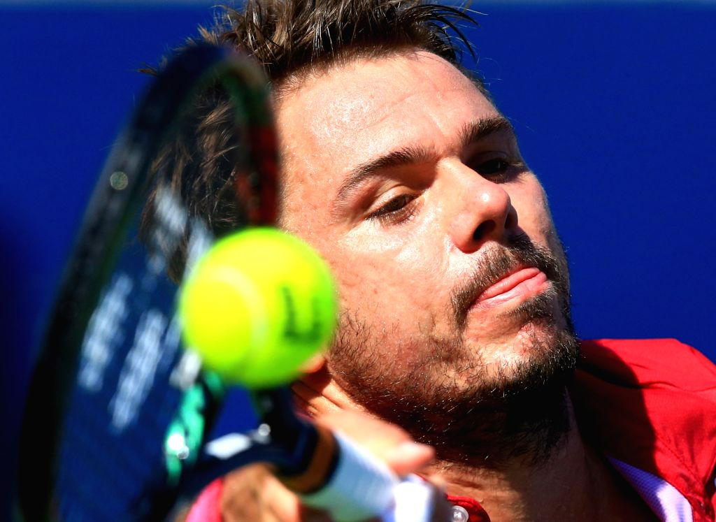 TORONTO, July 31, 2016 - Stan Wawrinka of Switzerland returns the ball against Kei Nishikori of Japan during their semifinal match of men's singles at the 2016 Rogers Cup in Toronto, Canada, July 30, ...