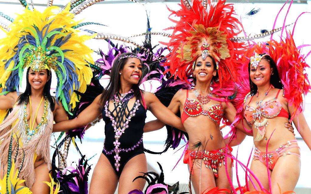 TORONTO, July 5, 2016 - Dressed up revellers perform during the official launch ceremony of the 2016 Toronto Caribbean Carnival at Nathan Philips Square in Toronto, Canada, July 5, 2016. As the ...