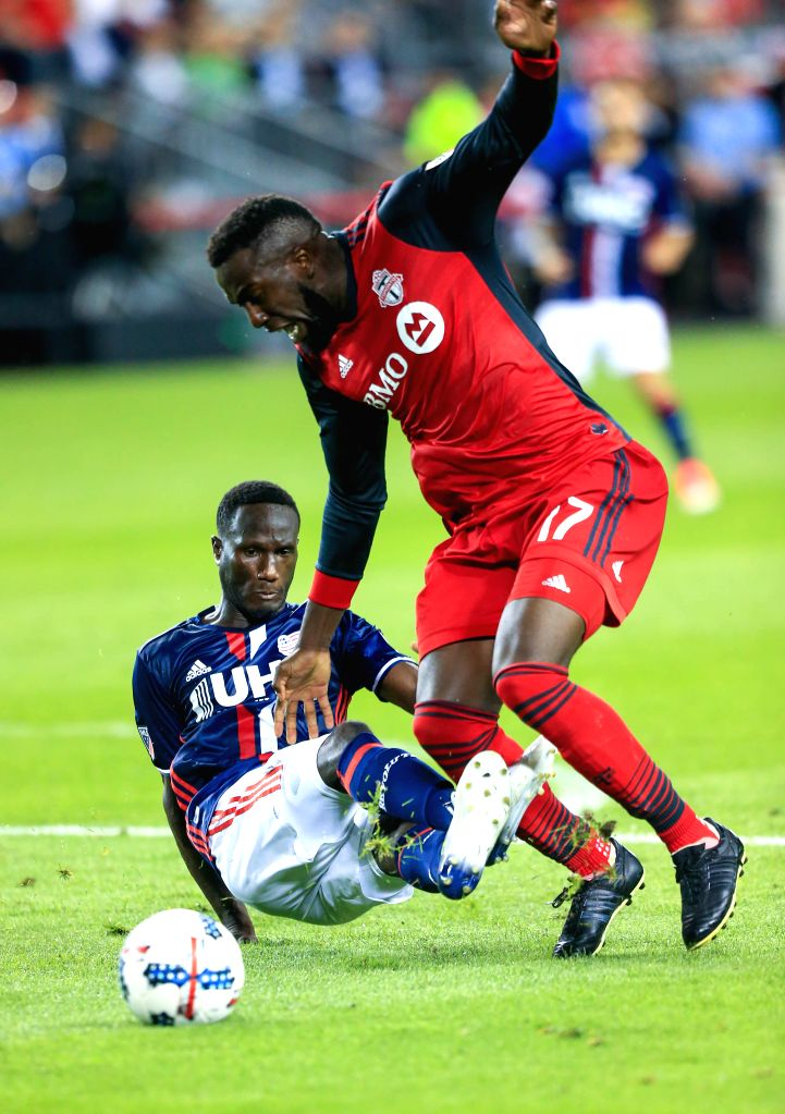 TORONTO, Jun. 24, 2017 -Jozy Altidore (R) of Toronto FC vies with Benjamin Angoua of New England Revolution during the 2017 ...