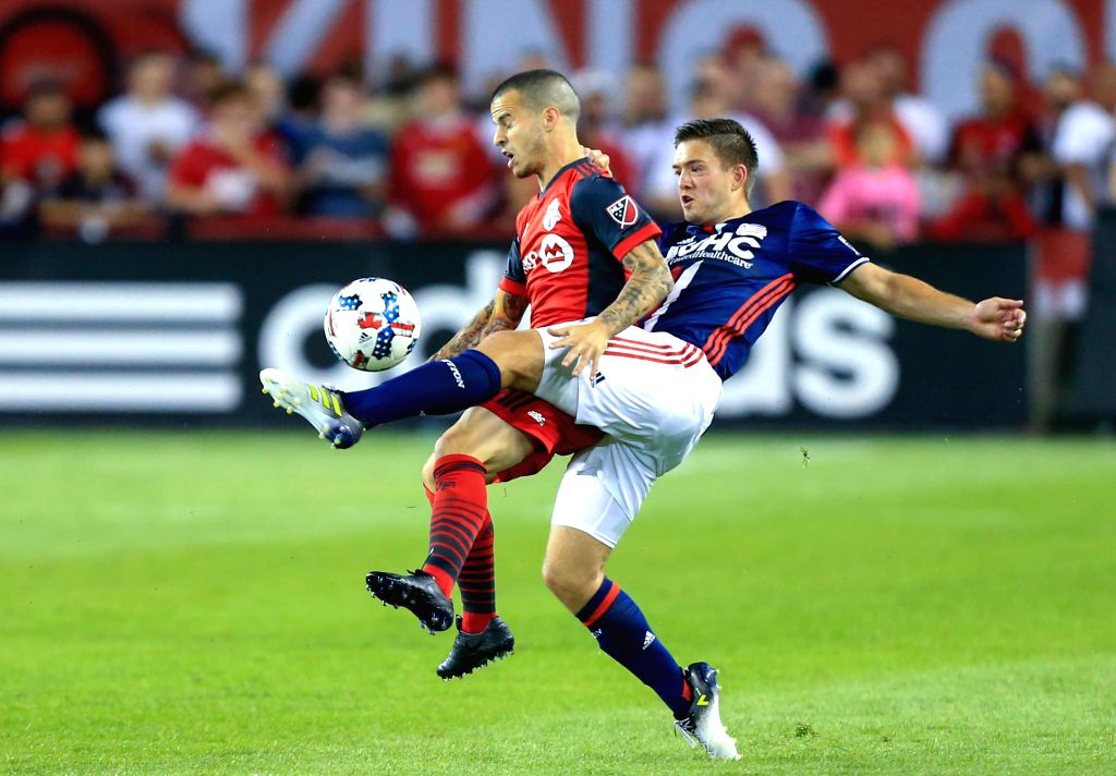 TORONTO, Jun. 24, 2017 - Sebastian Giovinco (L) of Toronto FC vies with Kelyn Rowe of New England Revolution during the 2017 Major League Soccer (MLS) match between Toronto FC and New England ...