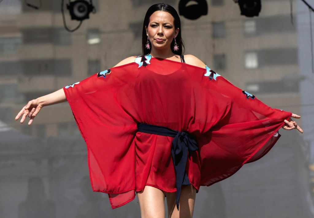 TORONTO, June 24, 2016 - A model walks the runway during the fashion show of the 2016 Aboriginal History Month Celebration at Yonge-Dundas Square in Toronto, Canada, June 23, 2016. Canada announced ...