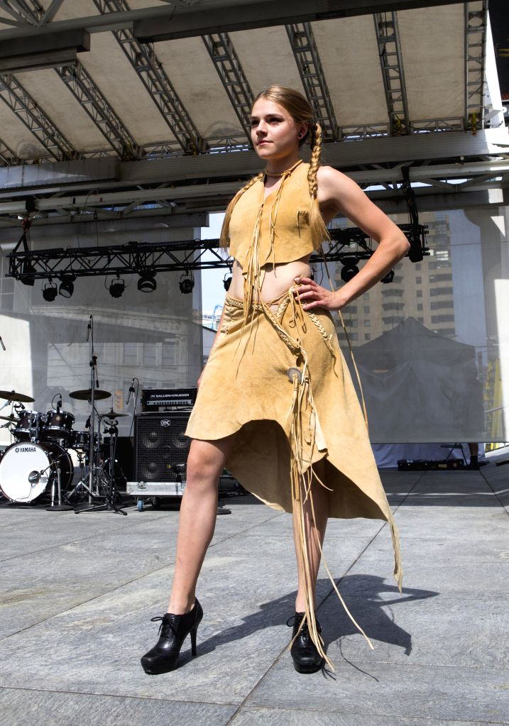 TORONTO, June 29, 2017 - A model presents a creation by the local indigenous designer during the fashion show of the 2017 Aboriginal History Month Celebration at Yonge-Dundas Square in Toronto, ...