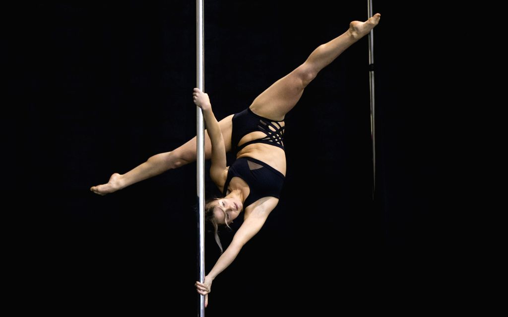 TORONTO, June 3, 2019 - A contestant competes during a pole fitness competition held by the Canadian Pole Fitness Association at the 2019 Toronto Pro SuperShow in Toronto, June 2, 2019.
