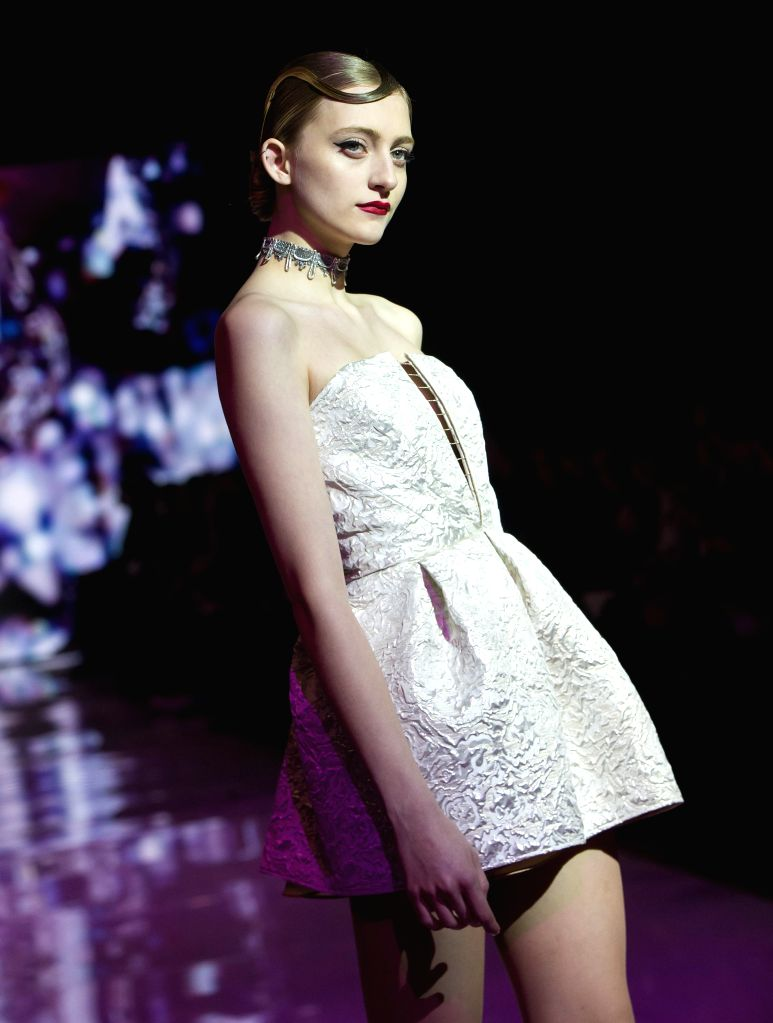 TORONTO, March 11, 2017 - A model presents a collection by Shelli Oh during the debut season of the Toronto Women's Fashion Week in Toronto, Canada, March 10, 2017. The three-day event will showcase ...