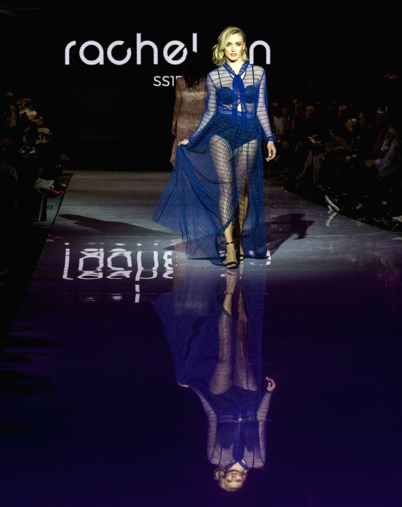 TORONTO, March 11, 2017 - A model presents a collection by Rachel Sin during the debut season of the Toronto Women's Fashion Week in Toronto, Canada, March 10, 2017. The three-day event will showcase ...