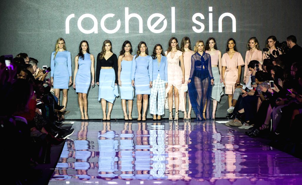 TORONTO, March 11, 2017 - Models present collections by Rachel Sin during the debut season of the Toronto Women's Fashion Week in Toronto, Canada, March 10, 2017. The three-day event will showcase ...