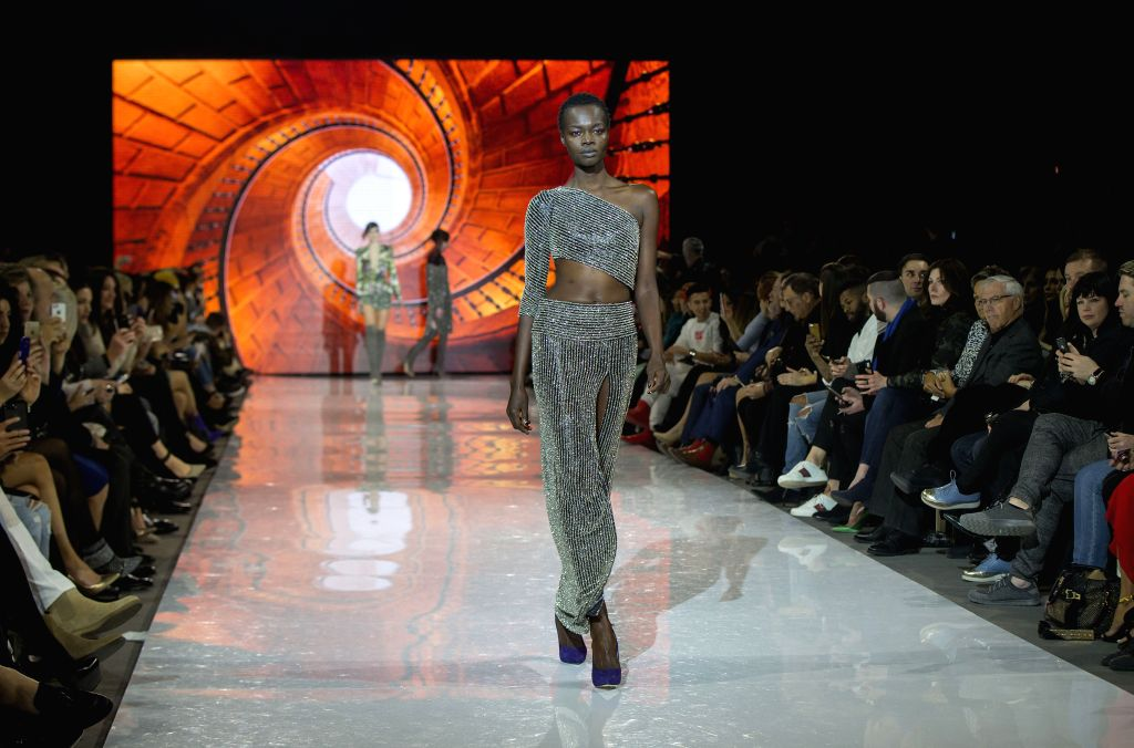 TORONTO, March 12, 2017 - A model walks the runway wearing Stephan Caras 2017 collection during the Toronto Women's Fashion Week in Toronto, Canada, March 11, 2017.