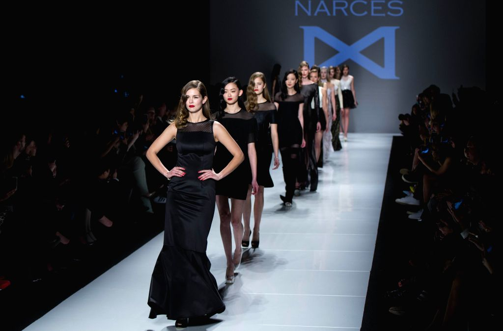 Models present creations of Narces fall 2015 collection during the World MasterCard Toronto Fashion Week Fall 2015 at David Pecaut Square in Toronto, Canada, March ...