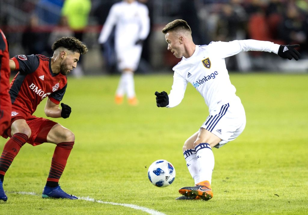 TORONTO, March 31, 2018 - Albert Rusnak (R) of Real Salt Lake controls the ball during the 2018 Major League Soccer (MLS) match between Toronto FC and Real Salt Lake at BMO Field in Toronto, Canada, ...