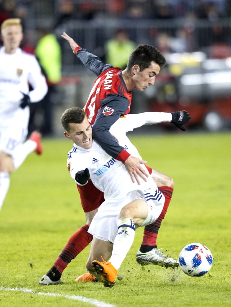 TORONTO, March 31, 2018 - Brooks Lennon (Front) of Real Salt Lake vies with Jay Chapman (C) of Toronto FC during the 2018 Major League Soccer (MLS) match at BMO Field in Toronto, Canada, March 30, ...