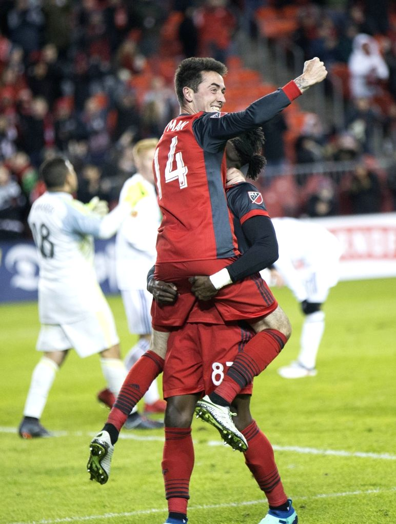 TORONTO, March 31, 2018 - Jay Chapman (Front) of Toronto FC celebrates scoring with teammate Tosaint Ricketts during the 2018 Major League Soccer (MLS) match between Toronto FC and Real Salt Lake at ...