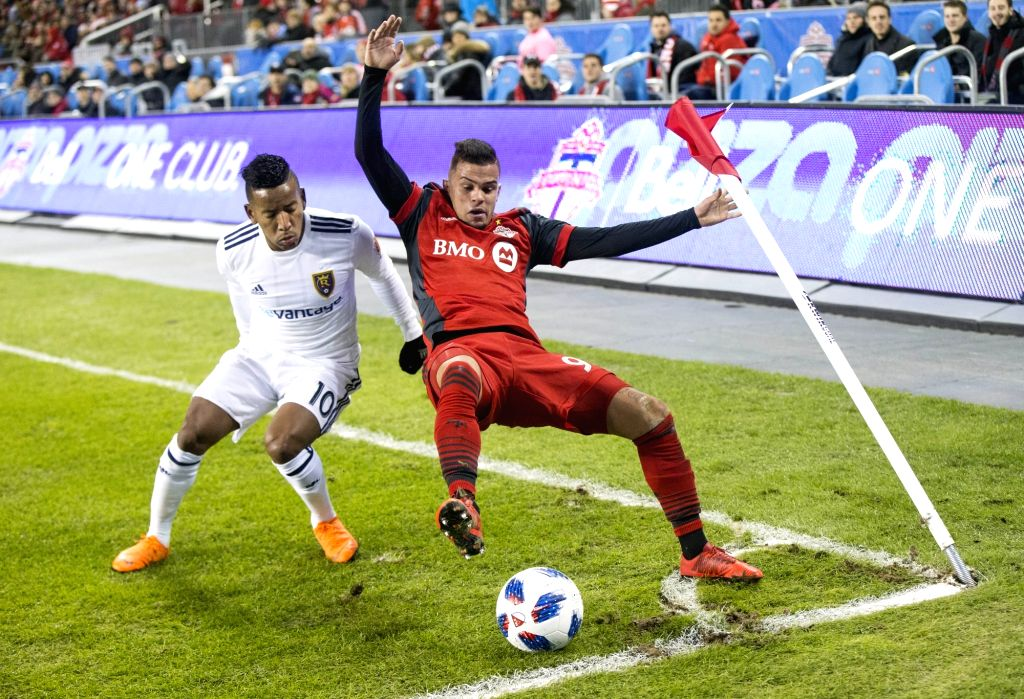 TORONTO, March 31, 2018 - Joao Plata (L) of Real Salt Lake vies with Auro of Toronto FC during their 2018 Major League Soccer (MLS) match at BMO Field in Toronto, Canada, March 30, 2018. Toronto FC ...