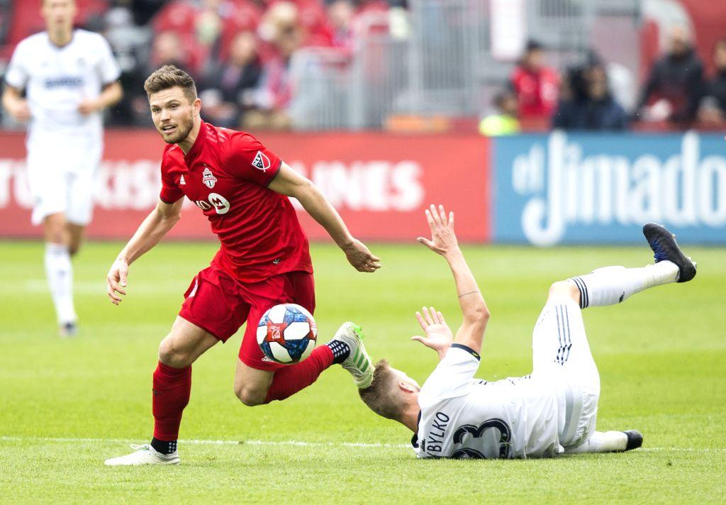 TORONTO, May 12, 2019 - Eriq Zavaleta (L) of Toronto FC vies with Kacper Przybylko of Philadelphia Union during a 2019 Major League Soccer (MLS) regular season match between Toronto FC and ...