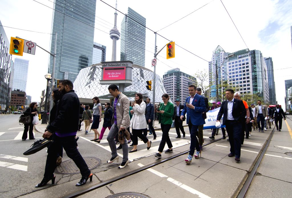 TORONTO, May 29, 2019 - Participants wearing high-heel shoes take part in the 2019 Walk a Mile in Her Shoes event in Toronto, Canada, May 29, 2019. More than 500 participants took part in the annual ...