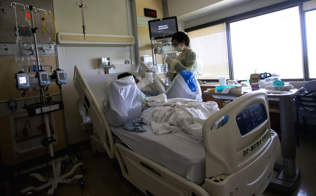 TORONTO, May 31, 2018 - A wounded student (L) receives treatment at a hospital in Toronto, Canada, May 30, 2018. A Chinese student of the University of Toronto is dead and three others are ...