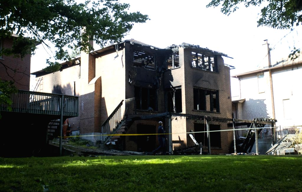 TORONTO, May 31, 2018 - The burnt house is seen in east Toronto, Canada, May 30, 2018. A Chinese student of the University of Toronto is dead and three others are hospitalized after a house fire ...