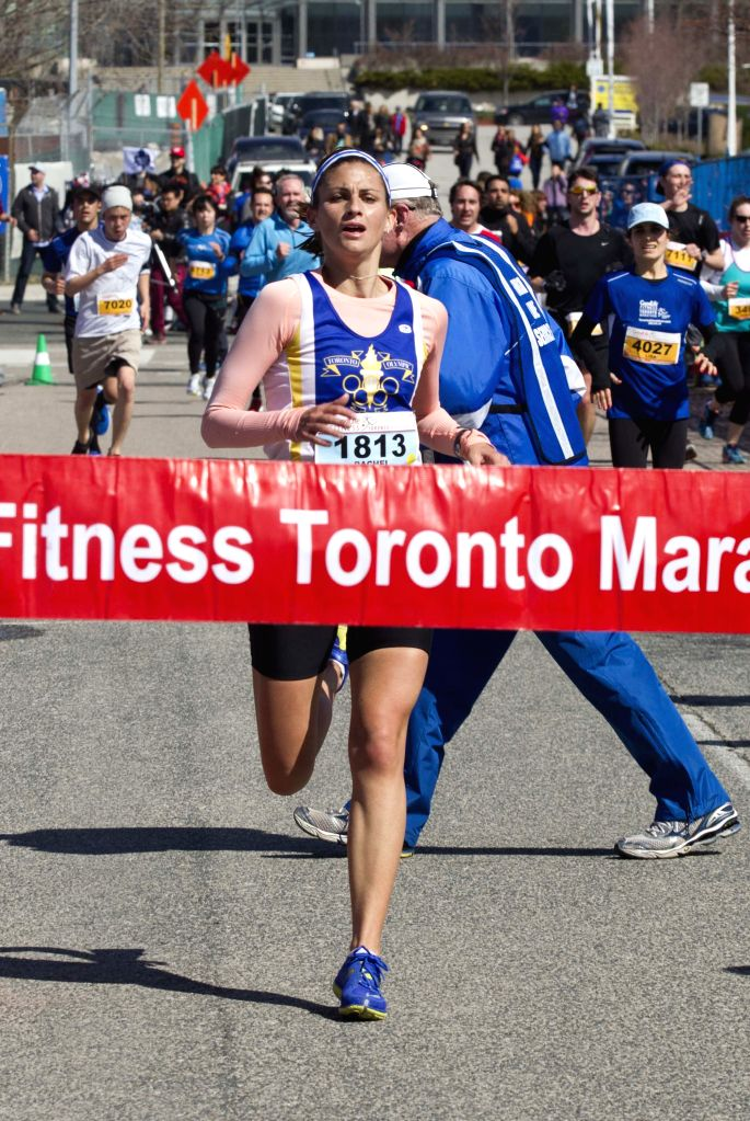Rachel Sinasac of Canada runs to the finish line to win women's marathon during the 2014 Toronto Marathon inToronto, Canada, May 4, 2014. About 15,000 runners from ...