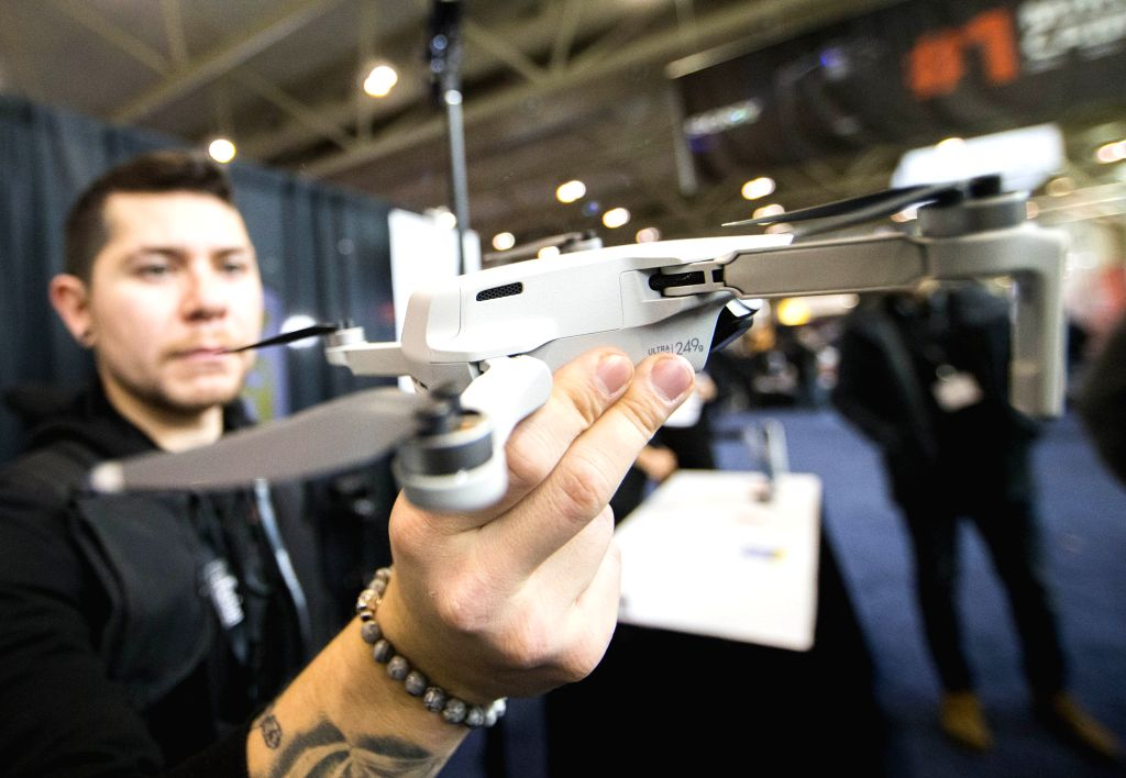 TORONTO, Nov. 13, 2019 - A man displays a DJI Mavic Mini ultralight drone with a weight of 249g during the 2019 ProFusion Expo in Toronto, Canada, Nov. 13, 2019. As the largest professional broadcast ...