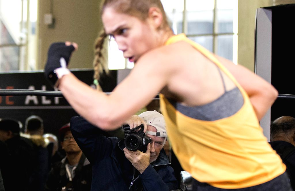 TORONTO, Nov. 13, 2019 - A man takes test shoots of sports photography during the 2019 ProFusion Expo in Toronto, Canada, Nov. 13, 2019. As the largest professional broadcast video and photo expo in ...